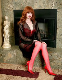 Hypnotic red headed cougar..